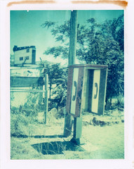Mexican Hat, UT (moominsean) Tags: polaroid 190 instant iduv expired042004 utah mexicanhat desert phone telephone abandoned summer faded
