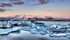 Sunrise at Jökulsárlón - Glacier Lagoon (BitRogue) Tags: nikon d800 1635mm iceland winter capturenx2 jökulsárlón ice glacier lagoon mountain estuary iceberg dawn morning goldenhour sunrise landscape wideangle water frozen vatnajökull breiðamerkurjökull lake national park