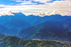 View from Mt. Syue, Taiwan. (Evo-PlayLoud) Tags: canoneos550d canon550d canon 550d efs18135mmf3556 efs 18135mm 18135mmkit mountain mountains sky bluesky cloud clouds cloudsstormssunsetssunrises landscape scenery mtsyue taichung taiwan blue          wulingfarm      green grass