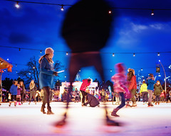 Skates (explored Dec 4, 2016) (mightymuffinful) Tags: feliznavidad godjul fun skates winter christmasseason people skating recreation cold niftyfiftylens silhouette brightcolours julelys skatingrink nikond750 fstoppers ice kelowna outdoors blue bright xmas december
