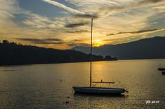 tramonto al Laveno-Mombello (gbistoletti) Tags: italia lombardia provinciadivarese lavenomombello tramonto lagomaggiore barche riflessi boschi nuvole panorama