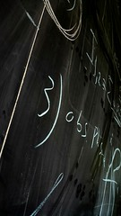 Scribbling on the board in the Snake Pit. (Mista Sparkle) Tags: abstract wall science math fermilab chalkboard