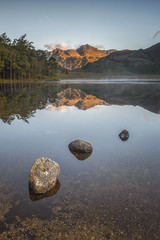 Blea Tarn on a Still Morning (Vemsteroo) Tags: morning light sunlight lake mountains water beautiful sunrise canon still rocks north lakedistrict cumbria fells 5d serene 24mm tse thelakes langdales mkiii bleatarn ndgrad visitengland leefilters visitbritain 09softgrad lansdalevalley