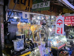 "Seoul Korea Se-un Electronics market turned-on retro backalley - ""Wired!"" (3) (moreska) Tags: signs diy asia mess market cd korea oldschool retro stereo cables wires electronics seoul displays weathered analogue hometheater narrow cramped clutter tatty brands piles rok hangul seun muddle"