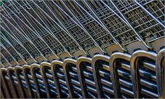45/52 : Uniformity of shooping carts [Explored] (Hervé Marchand) Tags: rennes bretagne uniform shopphingcart caddie metallic repetition minimal exterieur inexplore