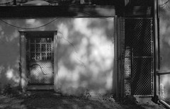 Fractured (geowelch) Tags: toronto downtown urbanfragments urbanlandscape shadows buildings urbandecay blackwhite monochrome 35mmfilm kodakt400cn pentaxesii 50mmf14supermulticoatedtakumar plustekopticfilm7400