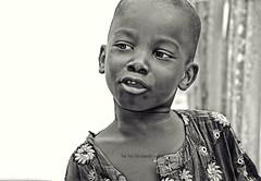 No words just click ...click.. (Ram Iyer Photography) Tags: portrait blackwhite africa tanzania uganda nigeria nikon canon ramiyer d5300 flickr sharp naturallighting handheld portraiture face faces boys kids play journalism published awarded