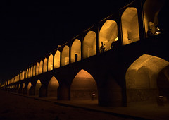 A view of the khaju bridge at night highlighting the arches, Isfahan province, Isfahan, Iran (Eric Lafforgue) Tags: arch arches architectural architecture bridge building centralasia city colorimage copyspace esfahan hispahan horizontal illuminated incidentalpeople iran iranian isfahan ispahan khajubridge landmark middleeast night outdoors people persia persian tourism touristic travel urban isfahanprovince ir