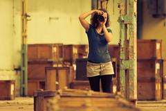That (Nikon) girl (shokisan) Tags: girl camera warehouse abandoned nikon boxes summer line curly stand poles