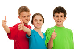 Group of smiling kids (mommymundoxyz) Tags: thumbup boy red kid fist girl face blue hand thumb green white smile three group laugh happy studio casual people person pretty friends success emotion gesture isolated handsome children relation happiness caucasian childhood confident friendship relationship