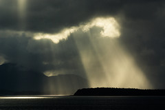 Deity du Jour (Prestidigitizer) Tags: ocean silhouette alaska clouds beams lightbeams glacierbay crepuscular godlight pentaxk10d pentaxda50135mm