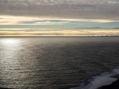 Nearly setting sun (katrin glaesmann) Tags: iceland vk beach unterwegsmiticelandtours photographyholidaywithicelandtours dyrhlaey clouds sand sea viewfromthecliff