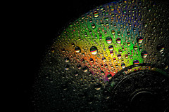 don't stop playing - 334/366 (auntneecey) Tags: waterdrops rainbow abstract tabletop cd music 366the2016edition 3662016 day334366 29nov16 odc whatimthankfulfor
