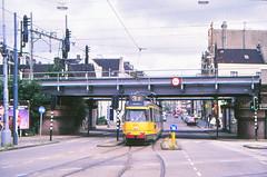 Once upon a time - The Netherlands - Amsterdam Zeeheldenbuurt (railasia) Tags: holland noordholland amsterdam zeeheldenbuurt gvb routenº3 articulatedmotorcar werkspoor infra railwaycrossing viaduct eighties