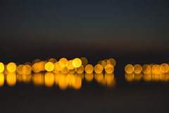 Bokeh. (Pablin79) Tags: sky reflections color night light abstract bokeh bright gold shadow colors evening dark blur illuminated argentina shining warmly misiones posadas citcles
