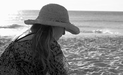 Day dreamer... (Michele's POV) Tags: candidportrait bythesea contemplative bnw blackandwhite backlight innocence blossoming jadore bnwphotography sea seaside monochrome thoughtful pensive wistful dreamer