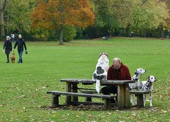 one man & his three dogs (helenoftheways) Tags: dogs ladywellfields lewisham dalmations bench mansbestfriends green autumn sit seated sitting littledoglaughedstories people