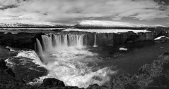 Meet me on the river of time (lunaryuna) Tags: iceland centralnorthiceland highlands myvatnregion landscape panorama waterfall godafoss rivercanyon riverskjlfandafljt playoftheelements wildlandscapes mountainrange sky cloudscape columnarbasalt gorge spring season seasonalchange lunaryuna blackwhite bw monochrome