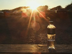 Water (laptoppingpong) Tags: bottle sunset newborough waterbottle