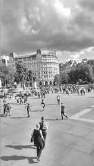 Transversing the square (IanAWood) Tags: london streetphotography trafalgarsquare westend mobilesnaps cameraphonephotography seenonmytravels notwalkingwithmynikon editedinsnapseed androidphotographers htconem8 humansoflondon landmarksfortourists