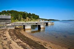 Docks in Charlottestown (wyojones) Tags: ocean houses sea canada beach newfoundland bay dock rocks waves atlantic hills np parkscanada terranovanationalpark charlottestown wyojones bryanshole cloudesound