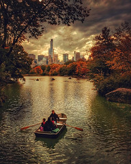 Rowing into Autumn (gimmeocean) Tags: nyc newyorkcity autumn ny newyork fall skyline centralpark manhattan fallfoliage rowing rowboat iphone thelake autumnalcolors iphoneography iphonenography snapseed appleiphone5s