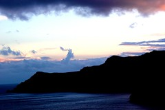 Caldera in the Aegean sea at Santorini (Nagarjun) Tags: blue sunset sun white church island volcano evening europe glow santorini caldera oia cyclades mediterranian firostefani aegeansea