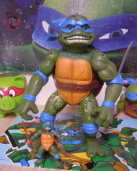 "Nickelodeon ""HISTORY OF TEENAGE MUTANT NINJA TURTLES"" FEATURING LEONARDO -  'MOVIE STAR' LEO viii / ..with GIANT MOVIE STAR Leo '92 (( 2015 )) (tOkKa) Tags: 2005 toys comic 1988 2006 1993 1992 leonardo figures bootleg toysrus 2012 2007 teenagemutantninjaturtles tmnt nickelodeon 2014 2015 displaystand playmatestoys ninjaturtlesthenextmutation toysrusexclusive tmntfastforward toontmnt tmntmovie4 turtlemilkstudios eastmanandlairdsteenagemutantninjaturtles moviestartmnt varnerstudios toonleo paramountteenagemutantninjaturtles 4kidstmnt paramountsteenagemutantninjaturtles tmnt2003 historyofteenagemutantninjaturtlesfeaturingleonardo giantmoviestartmnt davearshawsky tmnt2014movie"