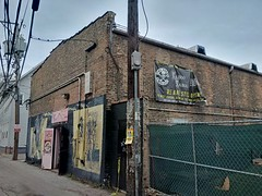 The Alley is Closing #5 (artistmac) Tags: street city urban chicago illinois punk belmont homeless goth teenagers il clark northside intersection gentrification lakeview counterculture dunkindonuts kurtcobain deathcertificate thealley clarkandbelmont blacktshirts bluehavana develoopment tabootabou architecturalrevolution