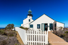 Old Point Loma Light (John H Bowman) Tags: california lighthouses december sandiego stonework historic blueskies sandiegocounty 2015 stonebuildings canon2470l nrhp lighthousetrek pacificlighthouses fencesgates oldpointlomalight calighthouses december2015