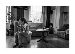 Girl with the phone (Jan Dobrovsky) Tags: bw contrast countrylife countryside document girl grain gypsies indoor krasnalipa leicaq portrait roma rural village blackandwhite monochrome