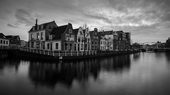 On the edge (McQuaide Photography) Tags: haarlem noordholland northholland netherlands nederland holland dutch europe sony a7rii ilce7rm2 alpha mirrorless 1635mm sonyzeiss zeiss variotessar fullframe mcquaidephotography adobe photoshop lightroom tripod manfrotto light licht availablelight dusk twilight schemering water reflection longexposure stad city urban river spaarne rivier waterside lowlight outdoor outside waterfront architecture skyline building gebouw wideangle wideanglelens 16mm groothoek cityscape widescreen panoramic 169 monochrome mono blackwhite bw blackandwhite classic authentic kortespaarne nd ndfilter 6stop bwfilters neutraldensity