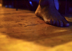 Intrigue (The Snige) Tags: fishnet stocking foot toes floor