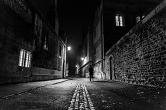 Stranger in the Night (darren.cowley) Tags: medieval windows architecture night highcontrast shadows silhouette lights street stone brick oxford brasenoselane darrencowley monochrome blackandwhite historic vanishingpoint stranger walls