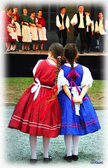 In whispers... (clevernails) Tags: hungary folklore whispers dress girls dance stage podium skirt festival waiting ponytail boys outdoor crop