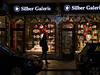 Walkthrough (H.H. Mahal Alysheba) Tags: munich münchen night street shop christmas snapshot pedesterian lumix gx7 leicadg summilux 25mmf14