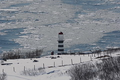 Lighthouse on the edge... (Sergei Golyshev (extremely busy but that's ok)) Tags: kamchatka pacific ocean coast petropavlovskiy lighthouse tower stripes nautical navigation marine maritime beacon engeneering historical cast iron snow lanscape sea water nature