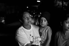 Little boy (Aadil Chouji Schiffer) Tags: people srilanka srilankan vesak season wesak sri lanka lankan human kid kids humans potrait night black white n blacknwhite blackwhite bnw bw bandw mono monochrome potraits nikon nikonpotrait d3300 nikond3300 nikon35mm 35mm nikkor nikkor35mm prime lens potraitlens primelens