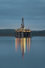 Ugly by day but a beautiful sight at night... (~Shurlee~) Tags: scotland invergordon oilrig platform repairs fuji long exposure tripod reflections colourful surreal industrial sea evening