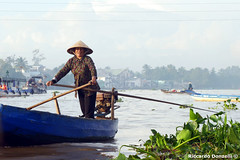 Lady on the river (riccardo.donzelli) Tags: vietnam travel backpacking backpacker asia lady river floating market mekong