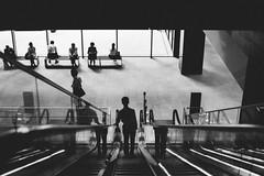 going down (ken_tsuda) Tags: street blackandwhite bw building lines silhouette contrast person 50mm tokyo office nikon cityscape f14 candid escalator indoor  fx goingdown   d810 kentsuda fullframe 20150820maman0855