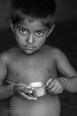 Slum child (andrej-trcek) Tags: poverty trip travel boy people blackandwhite bw food india dinner walking children lunch photography asia child eating eat hungry kolkata calcutta slum