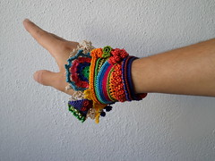 freeform crochet cuff with yellow, orange, red, turquoise blue, indigo and green beaded flowers by irregularexpressions (irregular expressions) Tags: orange thread yellow beads crochet cream indigo cotton button wearableart fiberart fiber fibers textileart olivegreen seedbeads rainbowcolors crochetflowers beadcrochet freeformcrochet delicabeads turquoiseblue crochetbracelet beadedcrochet beadedbracelet crochetart cottonthread cardinalred magentapink cottonfiber beadedcuff beadedlace irregularexpressions crochetcuff statementbracelet statementjewelry statementcuff beadedcrochetbracelet freeformcrochetbracelet