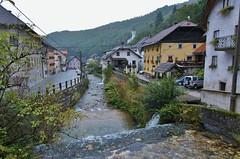Mountain village in Slovenia on rainy day (stevelamb007) Tags: foothills nature rain fog architecture buildings nikon stream d70s tokina slovenia superwideangle julianalps stevelamb 1116mmf28