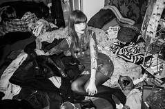 This girl likes mess (Gary Kinsman) Tags: highiso fujix100 fujifilmfinepixx100 london n16 stamfordhill stamfordhillestate party houseparty 2015 christmasparty bw blackwhite evening night flash pose posed bedroom mess messy people person