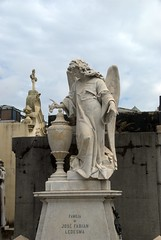 Angel with an urn atop a family grave (VinayakH) Tags: tombs tomb recoletacemetery recoleta larecoletacemetery cemetery buenosaires graves argentina latinamerica southamerica mausoleum artnouveau artdeco neogothic baroque architecture