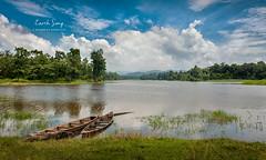 Earth Song (Dipankar Bordoloi) Tags: sky sunny landscape assam india northeastindia boat boats river lake water cloud green tree jungle