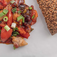 Served dish. Marinated pork, tomatoes and spring onions. Bun with cereals. (annick vanderschelden) Tags: addingflavor apricotjam aquamarina bowls brine bun cereals cooking culinary depthoffield enzymatic flavor honey hot immersion ingredients kitchenbowl kitchentool liquid marinade marinating marination oil pan pickling pork preparation process recipe seasoned sesameoil soaking springonions tomatoes wok wood