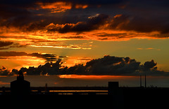 Skyline (Owen J Fitzpatrick) Tags: ojf people photography nikon fitzpatrick owen j joe rim pavement chasing d3100 ireland editorial use only ojfitzpatrick eire dublin republic city tamron sunset twilight cumulus cloud evening attenuation light sun amber yellow gold golden orange beam dusk blaze skyline wheel sunshine end poolbeg power station chimney pretty rimlit sundown pipes chimnies powerstation pier fiery sky gods esb electricireland electric