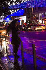It's in the wind, I am the savior (Sara_dreamy25) Tags: rain lluvia luces lights granvia madrid street calle canon canon1100d girl chica paraguas umbrella contraste